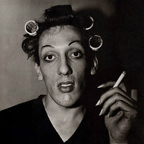 A young man in curlers at home on West